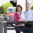 Farmer And Wife Looking Over Farm Gate — Stock Photo #4795911