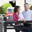 Farmer And Wife Looking Over Farm Gate — Stock Photo #4795912