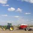 Tractor Planting Seed In Field - Stock Photo