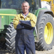 Driver Standing In Front Of Tractor — Stock Photo #4795981