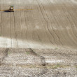 Stock Photo: Tractor Spraying Field