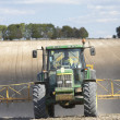 Tractor Spraying Field — Stock Photo #4795987