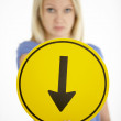 Royalty-Free Stock Photo: Woman Holding Road Traffic Sign