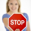 Woman Holding Road Traffic Sign — Stock Photo #4796026