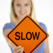 Woman Holding Road Traffic Sign - Stock Photo