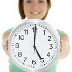 Woman Holding Clock Showing 5 O'Clock — Foto de Stock