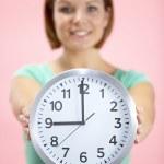 Woman Holding Clock Showing 9 O'Clock — Foto de Stock