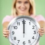Woman Holding Clock Showing 12 O'Clock — Foto de Stock