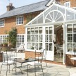 Exterior Of House With Conservatory And Patio — Stock Photo #4796244