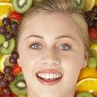 Portrait Of Young Woman Surrounded By Fruit — Stock Photo #4796277