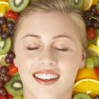 Portrait Of Young Woman Surrounded By Fruit — Stock Photo