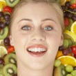 Portrait Of Young Woman Surrounded By Fruit — Stock Photo #4796286
