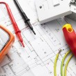 Electrical Equipment On House Plans — Stock Photo