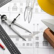 Building Equipment On House Plans - Stock Photo