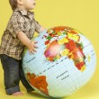 Toddler In Studio With Globe — Stock Photo