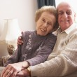 Loving Senior Couple Relaxing At Home — Stock Photo
