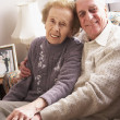 Foto Stock: Loving Senior Couple Relaxing At Home