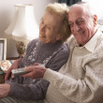 Senior Couple Watching TV At Home — Stock Photo #4796514