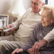 Stock Photo: Senior Couple Watching TV At Home