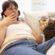 Overweight Woman Relaxing On Sofa — Stock Photo
