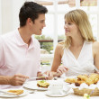 Young Couple Enjoying Hotel Breakfast — Stock Photo