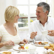Middle Aged Couple Enjoying Hotel Breakfast — Stock Photo