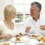 Middle Aged Couple Enjoying Hotel Breakfast — Stock Photo