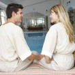 Young Couple Relaxing By Swimming Pool — Stock Photo