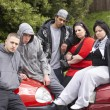 Gang Of Youths Sitting On Cars — Stock Photo #4796746