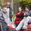 Gang Of Youths Sitting On Cars — Stock Photo
