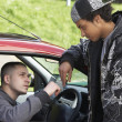 Young Man Dealing Drugs From Car - Stock Photo