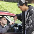 Young Man Dealing Drugs From Car - Foto Stock