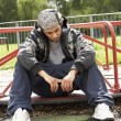 Young Man Sitting In Playground — Stock Photo #4796766