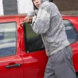 Young Man Breaking Into Car — Stock Photo #4796792