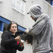 Man Mugging Woman In Street — Stock Photo #4796795