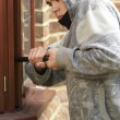 Young Man Breaking Into House — Stock Photo