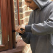 Young Man Breaking Into House — ストック写真