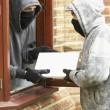 Young Men Breaking Into House — Stock Photo #4796824