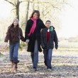 Mother And Children On Autumn Walk — Stock Photo