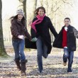 Mother And Children On Autumn Walk — Stock Photo #4796837