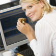 BusinesswomEnjoying Sandwich During Lunchbreak — Stock Photo #4796974