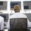 Stock Traders Viewing Monitors — Stock Photo