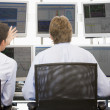 Stock Photo: Stock Traders Viewing Monitors