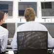 Stock Traders Viewing Monitors — Stock Photo