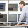 Stock Photo: Stock Trader Examining Computer Monitors