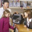 Girl And Father Taking Cat For Examination By Vet — Foto Stock
