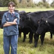 Stock Photo: Portrait Of Vet In Field With Cattle