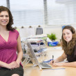 Stock Photo: Women happily working in office