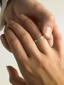 Man Putting Diamond Ring On Woman's Finger — Stock Photo
