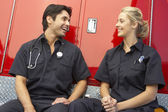 Two paramedics laughing together — Stock Photo